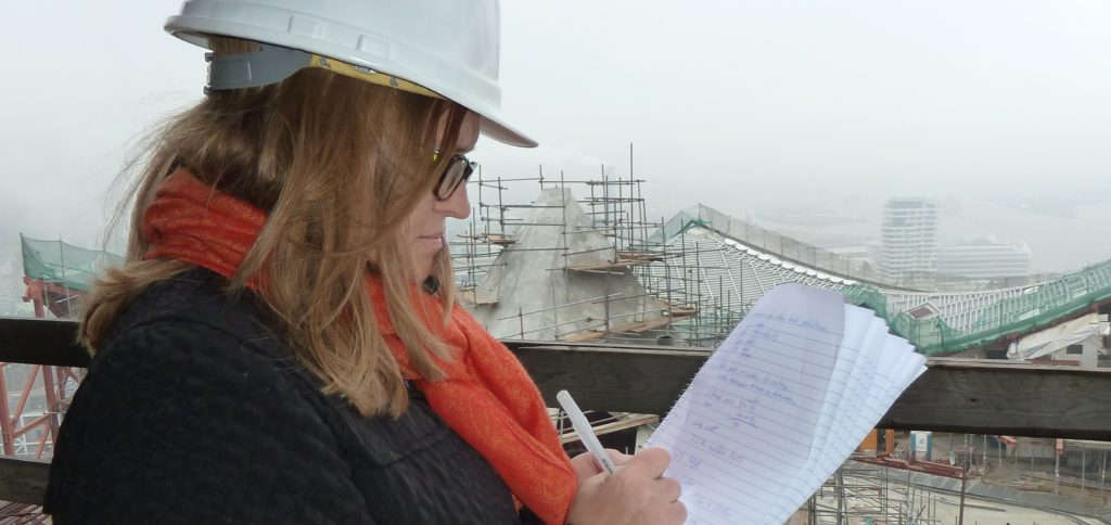 Lori Tripoli is taking notes at the Elbphilharmonie in Hamburg, Germany while the building is under construction.